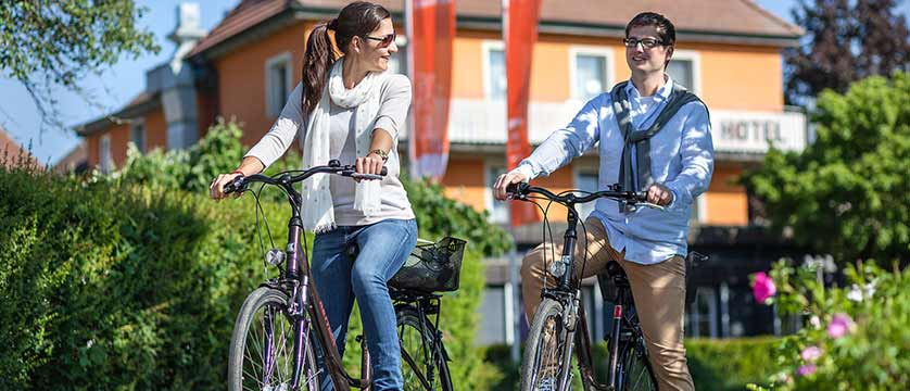 Ganter Hotel Mohren, exterior view with cycling couple, Lake Constance, Germany.jpg